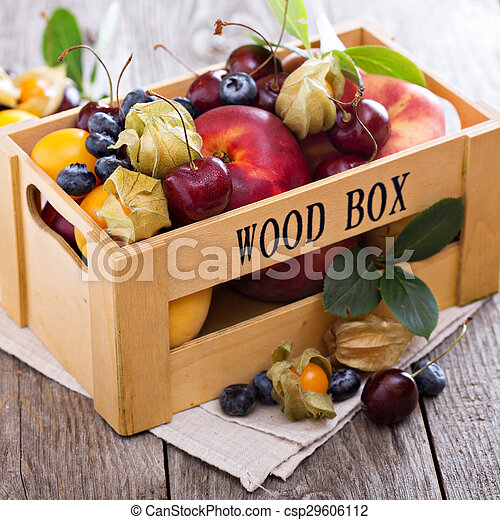 Fresh fruits in a wooden crate - csp29606112