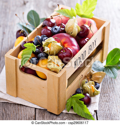Fresh fruits in a wooden crate - csp29606117