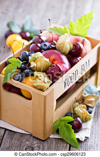 Fresh fruits in a wooden crate - csp29606123