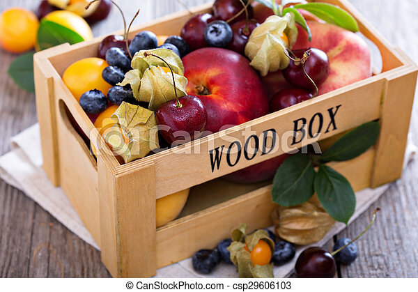 Fresh fruits in a wooden crate - csp29606103