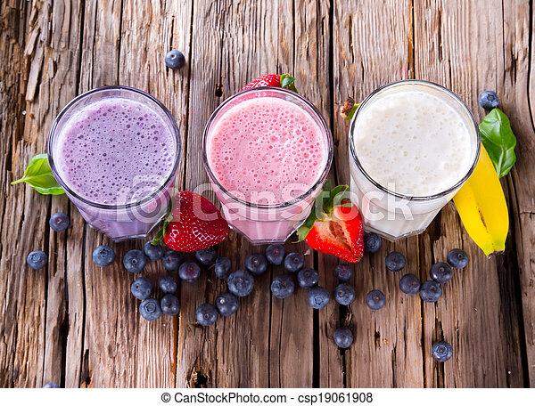 Fresh fruits milk shake on wood - csp19061908