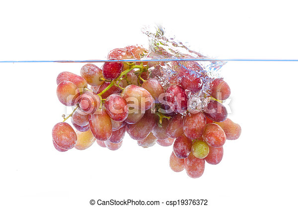 fresh grape dropped into water with splash isolated on white - csp19376372