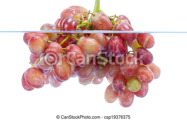 fresh grape dropped into water with splash isolated on white - csp19376375