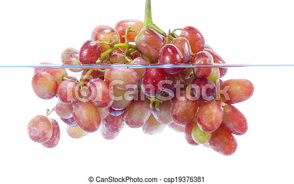 fresh grape dropped into water with splash isolated on white - csp19376381