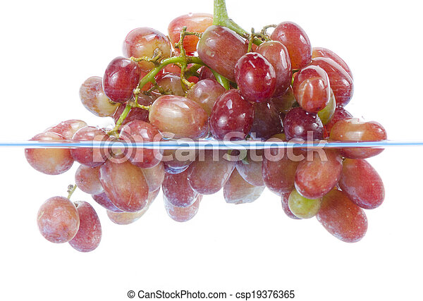 fresh grape dropped into water with splash isolated on white - csp19376365