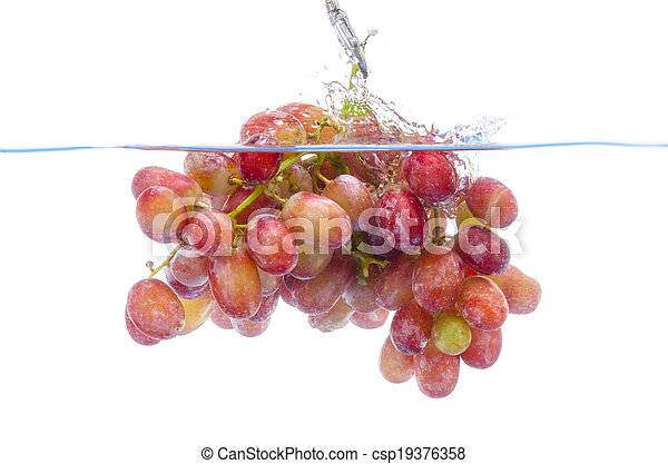 fresh grape dropped into water with splash isolated on white - csp19376358