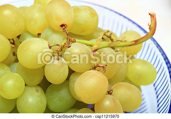 fresh grape fruits with green leaves - csp11215970