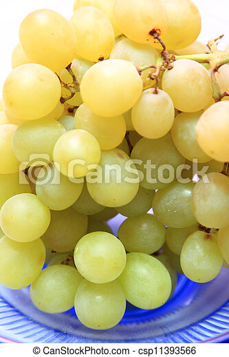 fresh grape fruits with green leaves - csp11393566