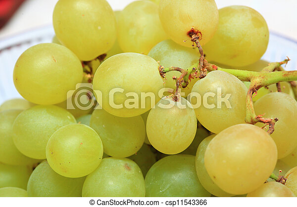 fresh grape fruits with green leaves - csp11543366