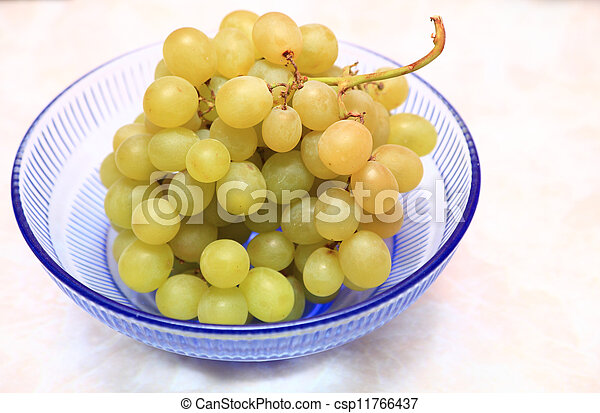 fresh grape fruits with green leaves - csp11766437