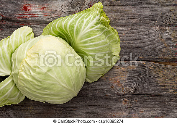 Fresh green cabbage on a wooden table - csp18395274