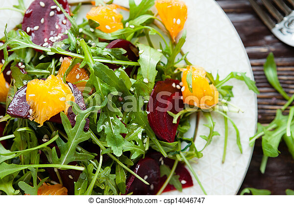 fresh green salad with arugula and beets - csp14046747