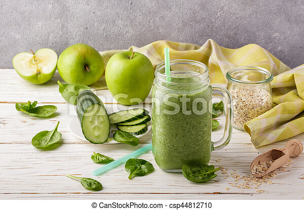 Fresh green smoothie from fruit and vegetables for a healthy lifestyle and ingredients for making dietary drink (spinach, green Apple, cucumber, oatmeal). Selective focus - csp44812710
