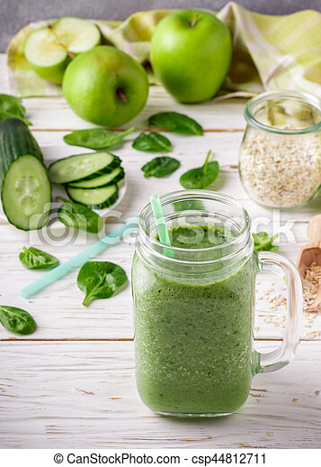 Fresh green smoothie from fruit and vegetables for a healthy lifestyle and ingredients for making dietary drink (spinach, green Apple, cucumber, oatmeal). Selective focus - csp44812711