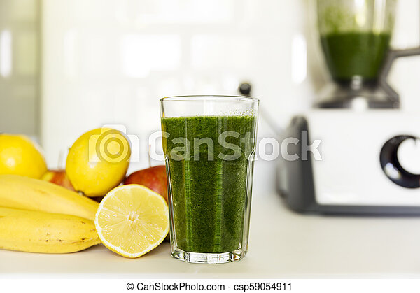Fresh green smoothie from fruit and vegetables for a healthy lifestyle. Spinach, apple, banana, lemon. - csp59054911