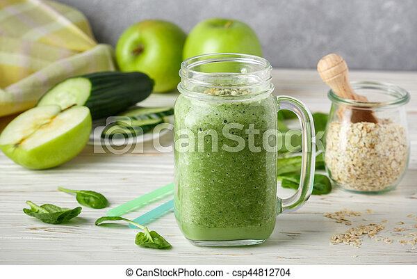 Fresh green smoothie from fruit and vegetables for a healthy lifestyle and ingredients - csp44812704