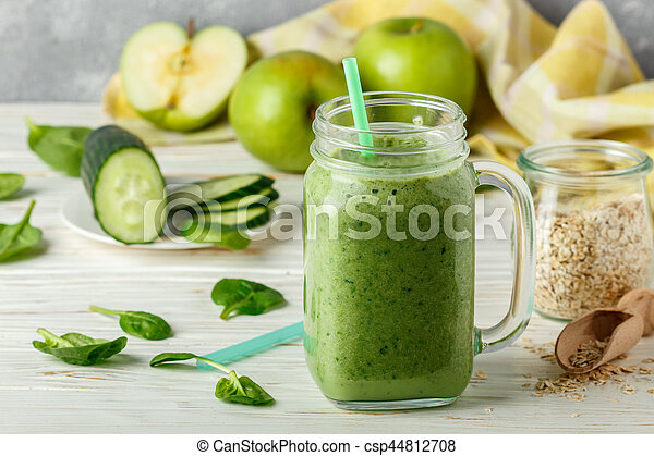 Fresh green smoothie from fruit and vegetables for a healthy lifestyle and ingredients for making dietary drink (spinach, green Apple, cucumber, oatmeal). Selective focus - csp44812708