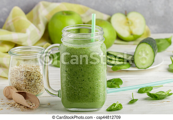 Fresh green smoothie from fruit and vegetables for a healthy lifestyle and ingredients for making dietary drink (spinach, green Apple, cucumber, oatmeal). Selective focus - csp44812709