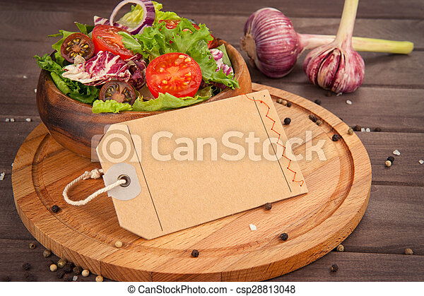 Fresh healthy salad on wooden table. - csp28813048