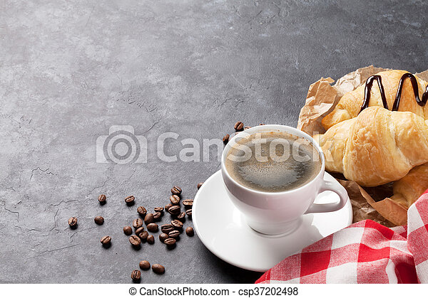 Fresh homemade croissants with chocolate and coffee - csp37202498