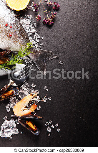 Fresh ingredients for a seafood meal - csp26530889
