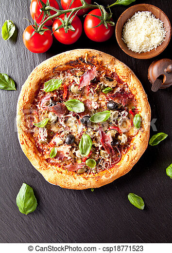 Fresh italian pizza served on black stone - csp18771523