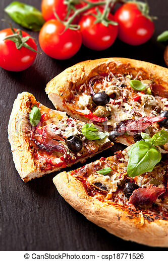 Fresh italian pizza served on black stone - csp18771526