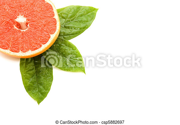 Fresh juicy grapefruits with green leafs. Isolated - csp5882697