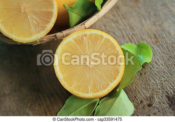 fresh lemon with leaves - csp33591475
