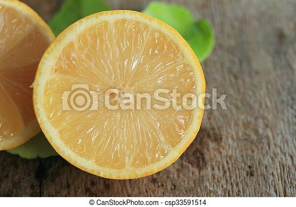 fresh lemon with leaves - csp33591514