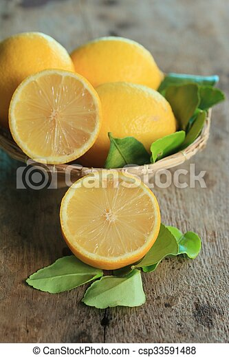 fresh lemon with leaves - csp33591488