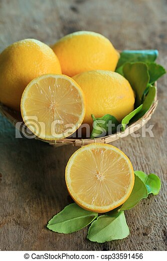 fresh lemon with leaves - csp33591456
