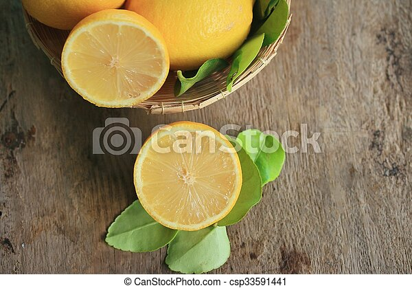 fresh lemon with leaves - csp33591441