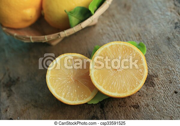fresh lemon with leaves - csp33591525