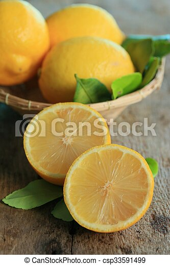 fresh lemon with leaves - csp33591499