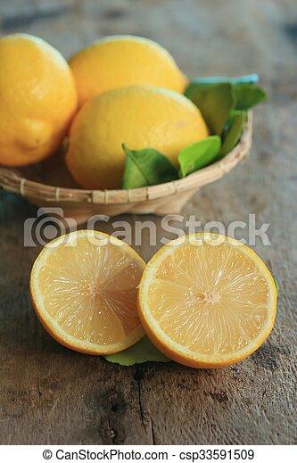 fresh lemon with leaves - csp33591509