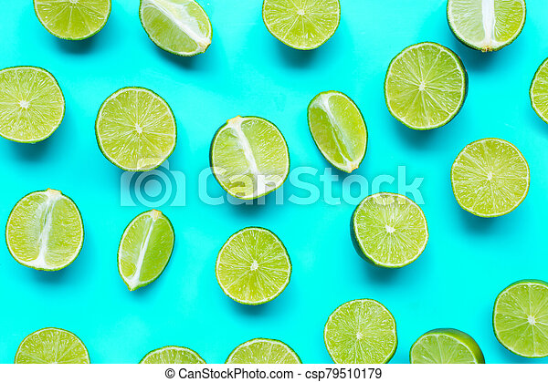 Fresh limes on blue background. top view - csp79510179