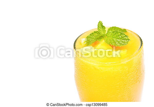 Fresh mango juice in a glass on white background - csp13099485