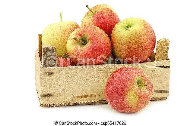 fresh Maribelle apples in a wooden crate - csp65417026