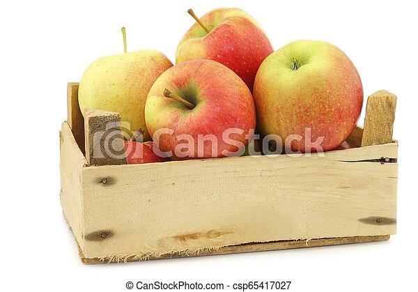 fresh Maribelle apples in a wooden crate - csp65417027