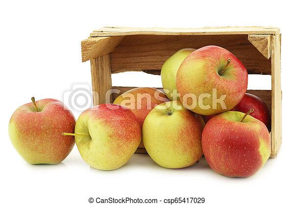 fresh Maribelle apples in a wooden crate - csp65417029