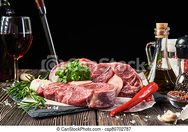 Fresh meat on a wooden background - csp80702787