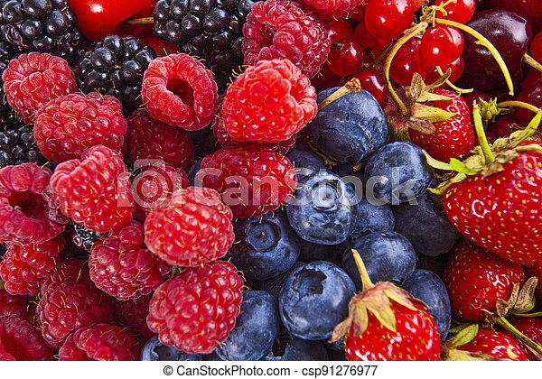 Fresh mixed summer berries - raspberry, strawberry, blueberry - csp91276977