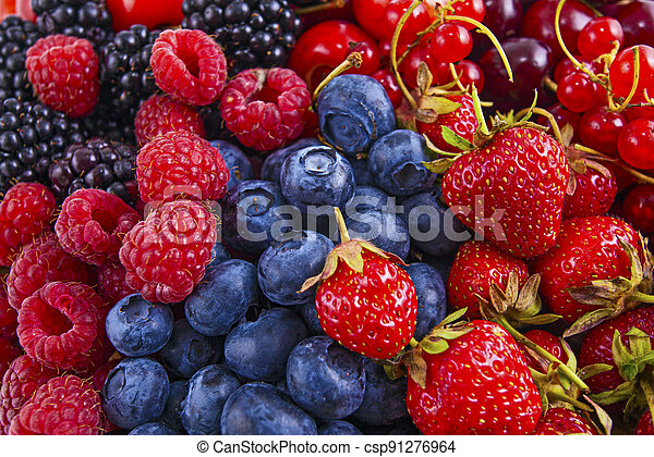 Fresh mixed summer berries - raspberry, strawberry, blueberry - csp91276964
