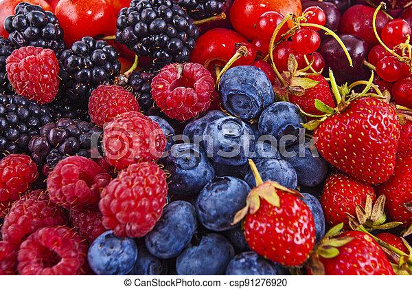 Fresh mixed summer berries - raspberry, strawberry, blueberry - csp91276920