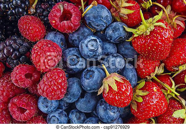 Fresh mixed summer berries - raspberry, strawberry, blueberry - csp91276929