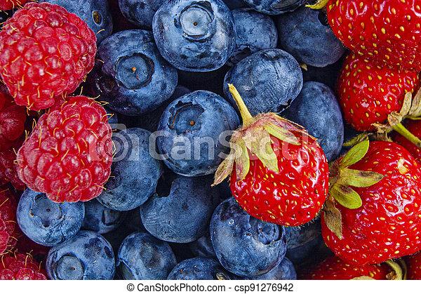 Fresh mixed summer berries - raspberry, strawberry, blueberry - csp91276942