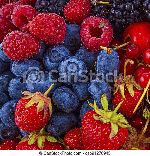 Fresh mixed summer berries - raspberry, strawberry, blueberry - csp91276945