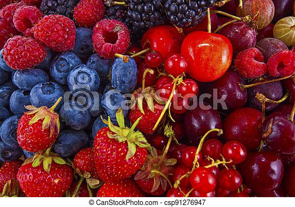 Fresh mixed summer berries - raspberry, strawberry, blueberry - csp91276947