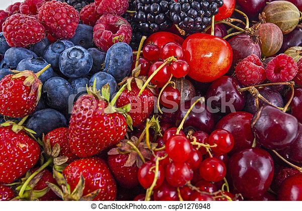 Fresh mixed summer berries - raspberry, strawberry, blueberry - csp91276948